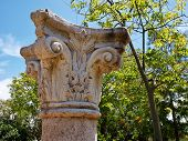 stock photo of ionic  - Details of a Corinthian Greek Ionic Roman Classical Marble Column with sky background - JPG