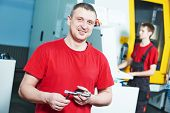 image of manufacturing  - mechanical industrial worker at cnc milling machine center in tool manufacture workshop - JPG