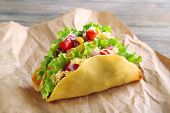 foto of tacos  - Tasty taco with vegetables on paper close up - JPG