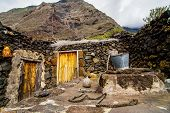 image of stone house  - Exterior of Abandoned Stone Made Houses In a Medieval Village El Hierro Island Spain - JPG