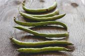 stock photo of bean-pod  - Broad Beans on Grunge Wooden Table - JPG