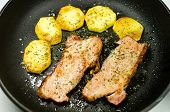 picture of gold panning  - Bacon and potatoes fried in a pan - JPG