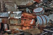 picture of day judgement  - Group of old rusty barrels with toxic chemical waste - JPG