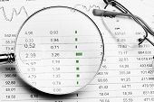 picture of stock market data  - Stock market listing Business chart and financial data on desk - JPG