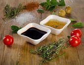 stock photo of vinegar  - Dressing ingredients on a rustic background - JPG