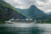 stock photo of passenger ship  - Cruise ship standing near Geiranger town Norway - JPG