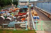 picture of machinery  - Heavy machinery spares production in stock in the open air without a roof - JPG