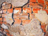 image of fragmentation  - Fragment of an old peeling brick wall with wide angle fisheye lens view - JPG