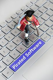 image of pirates  - Model Pirate On Top Of A Keyboard With A Spacebar Writing  - JPG