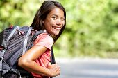 Happy young Asian Chinese backpack girl student. Cute adult woman backpacker smiling at camera with  poster