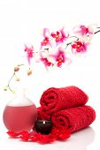Spa towel, candle, essential oils