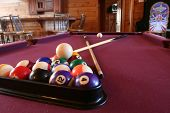 A billiards table is ready to play