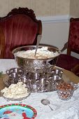 stock photo of punchbowl  - eggnog in this beautiful silver punch bowl is the perfect beverage for a christmas party - JPG
