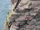 Climbers accending the 'Old Man of Stoer, in the Scottish Highlands