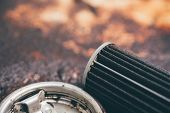 Old Lubricant Engine Oil Filter At Car Garage poster
