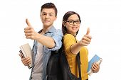 Teenage students with backpacks and books making thumb up gestures isolated on white background poster