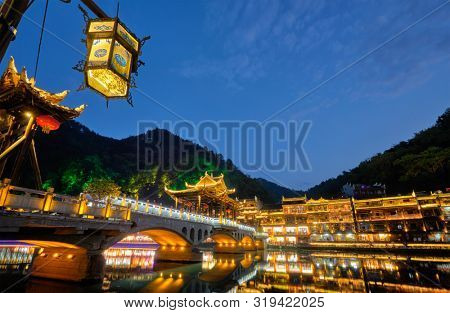 poster of Chinese tourist attraction destination - Feng Huang Ancient Town (Phoenix Ancient Town) on Tuo Jiang
