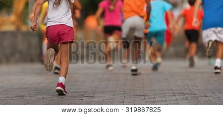 poster of Running Children, Young Athletes Run In A Kids Run Race,running On City Road Detail On Legs