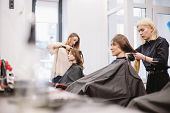 Beautiful Woman Combing Wet Hair. Stylist Brushing Woman Hair In Salon. Hairdresser Serving Customer poster