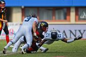VIENNA, AUSTRIA - JULY 16 RB Jerome Morris (#31 Germany) is tackled at the Football World Championsh