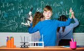 Little Children. Science. Little Kids Scientist Earning Chemistry In School Lab. Lab Microscope And  poster