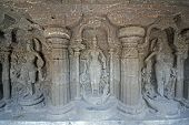 image of ellora  - Religious figures carved into solid rock inside the ancient Hindu Temple (Kailas Temple). Cave number 16 Ellora Caves near Aurangabad India. 8th Century AD