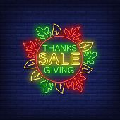 Thanksgiving Sale In Neon Style. Glowing Neon Text. Leaves, Discounts, Thanksgiving Day. Night Brigh poster