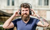 Hipster Enjoy Excellent Sound Song In Earphones. Walking With Music. Music Beat For Energetic Mood.  poster