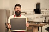Man Bearded Hipster Red Apron Stand In Kitchen. Kitchen Furniture Store. Kitchen Hacks Concept. Clev poster