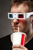 pic of matinee  - Portrait of man watching 3D movie and drinking soda - JPG