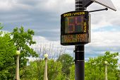 A Bilingual Radar Speed Sign Warns A Driver That Their Speed Of 54 Km/h Is Too Fast For The Posted L poster