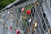 Love Padlocks Attached To A Steel Bridge, Also A Padlock In Shape Of The Heart poster