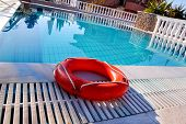 Red Lifebuoy Pool Ring At Swimming Pool. Red Pool Ring In Cool Blue Refreshing Blue Pool, Room For Y poster