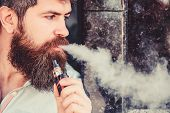 Man With Beard Breathe Out Smoke. Smoking Electronic Cigarette. Stress Relief Concept. Smoking Devic poster