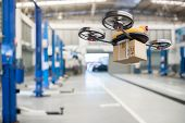 Spare Part Delivery Drone At Garage Storage In Leading Automotive Car Service Center For Delivering  poster