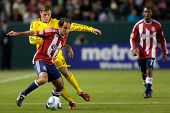 CARSON, CA. - APRIL 9: Chivas USA M Nick LaBrocca #10 & Columbus Crew F Robbie Rogers #18 during the