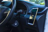 Smartphone In A Car Use For Navigate Or Gps. Driving A Car With Smartphone In Holder. Mobile Phone B poster
