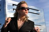 pic of brass knuckles  - business woman with clenched fists and brass knuckles ready for a fight - JPG