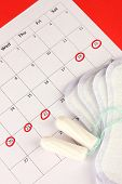 image of tampon  - menstruation calendar with sanitary pads and tampons - JPG