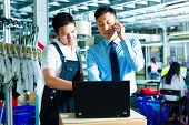 Worker or production manager and customer service, look on a laptop in a textile factory and help on