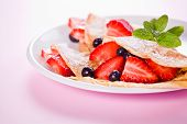Strawberries And Crepes