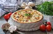 foto of cherry pie  - Traditional french quiche pie with chicken and mushroom on a plate