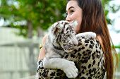 picture of white tiger cub  - pretty women hold baby white bengal tiger - JPG