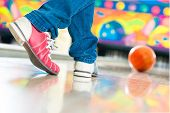 foto of bowling ball  - Young man in bowling alley having fun - JPG