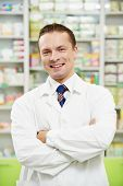 pharmacist chemist man standing in pharmacy drugstore