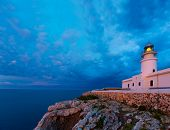 Menorca sunset in Faro Far de Caballeria Lighthouse at Balearic Islands es Mercadal