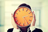 picture of running-late  - Businesswoman with clock - JPG