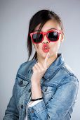 stock photo of pouting  - Asia woman pout lip with sunglasses - JPG