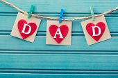 foto of grating  - Fathers day message on felt hearts over blue wooden board - JPG