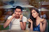image of breakup  - Young adult couple arguing with funny expressions and gestures - JPG